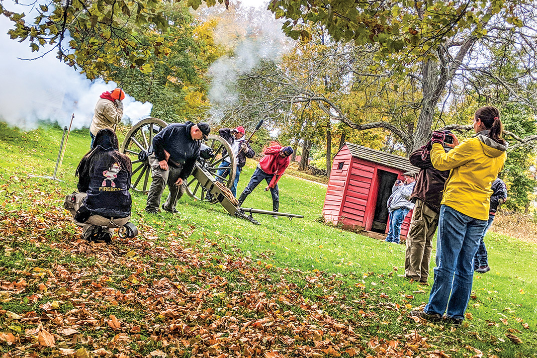 Students take measures as Civil War-era cannon is discharged.