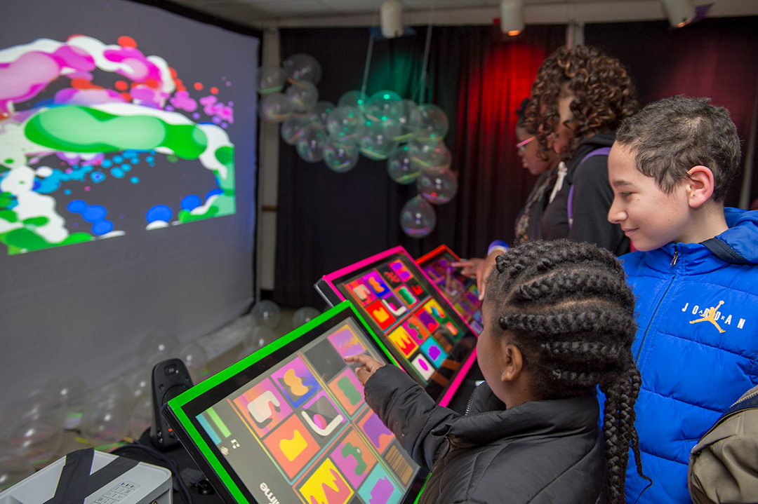 Students use colorful touchscreens.