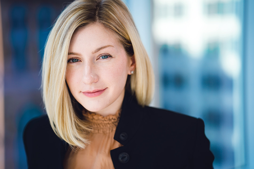 Head-and-shoulders view of woman wearing black blazer