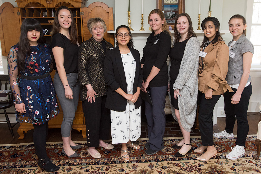 Group of eight women poses.