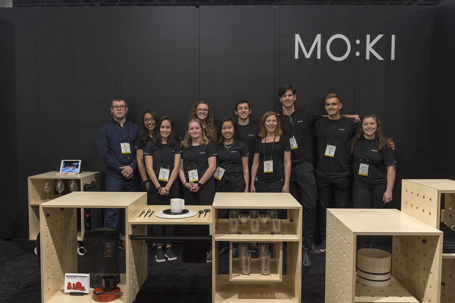 Students and faculty pose for a photo at the ICFF booth