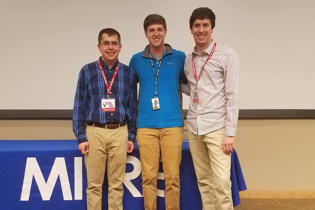 'Three students standing '