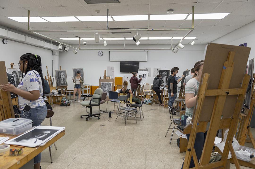 High school students work in an RIT painting studio