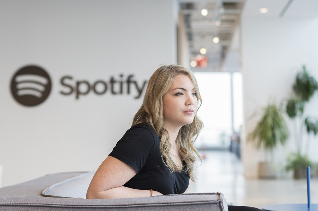 Emmi Hintz sits in a lobby of Spotify's New York City office