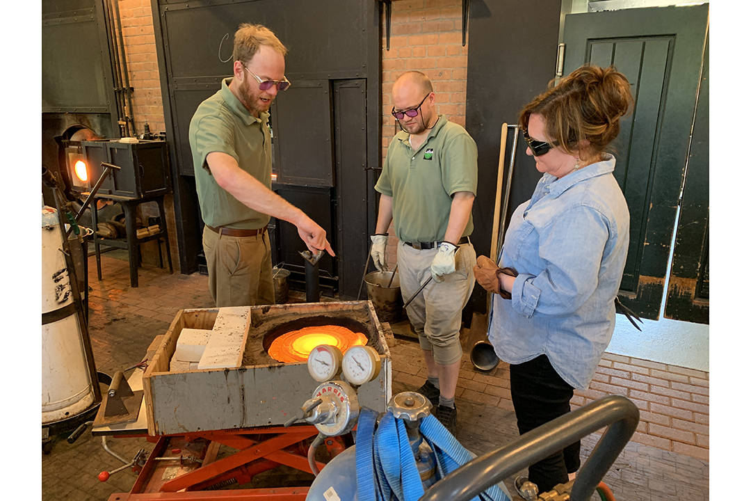Three glassblowers — including Andy Koupal and Robin Cass — work at the Henry Ford Museum.