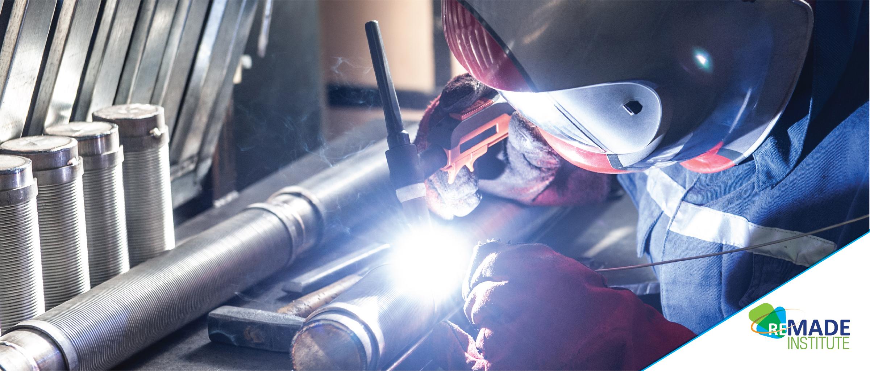 Man welding metal pipe