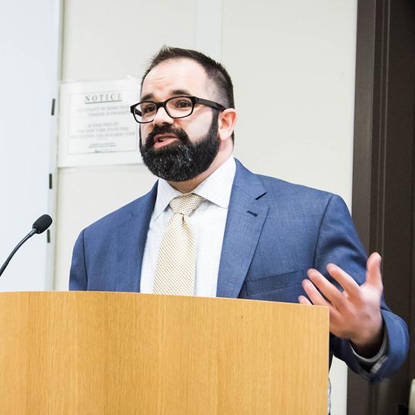 Dr. David Reidmiller standing at podium
