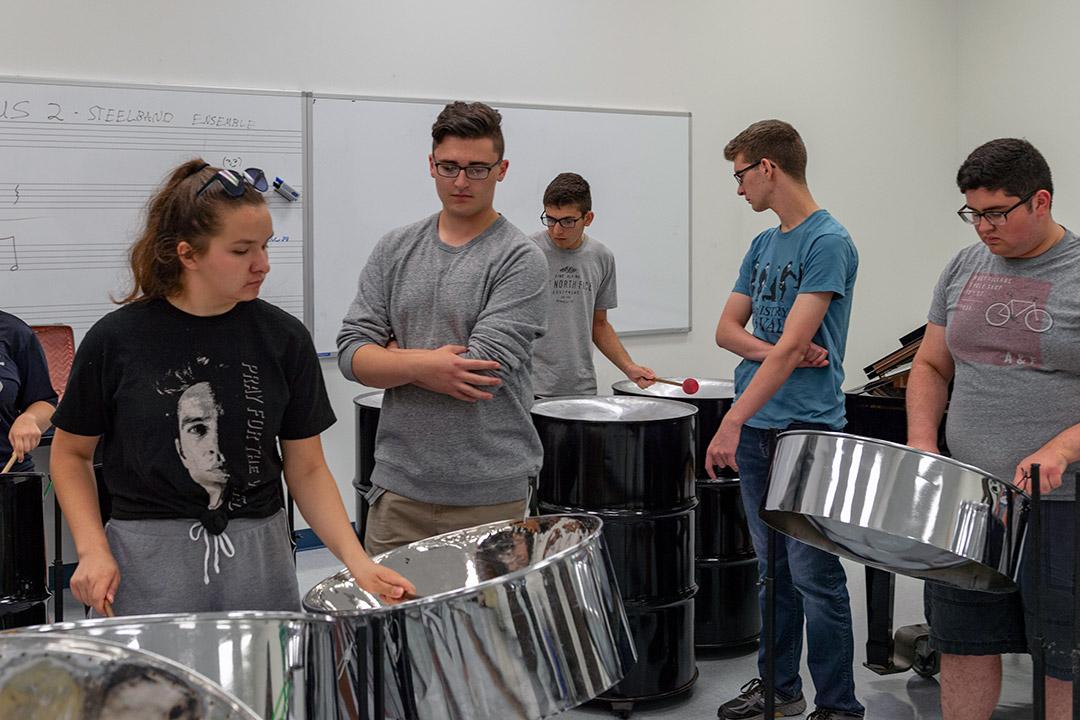 Students play steel drums.