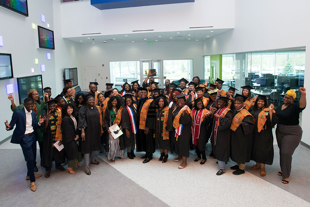 'Large group of graduating students.'