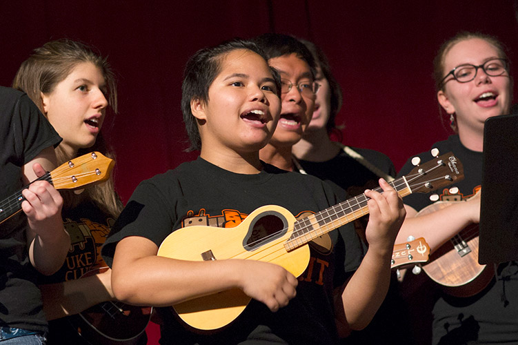 Students sing and play ukuleles.