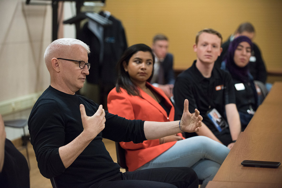'Anderson Cooper talks with students.'