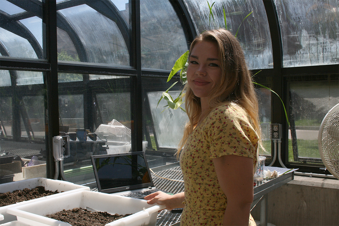photo of Abby Rolston in the RIT greenhouse