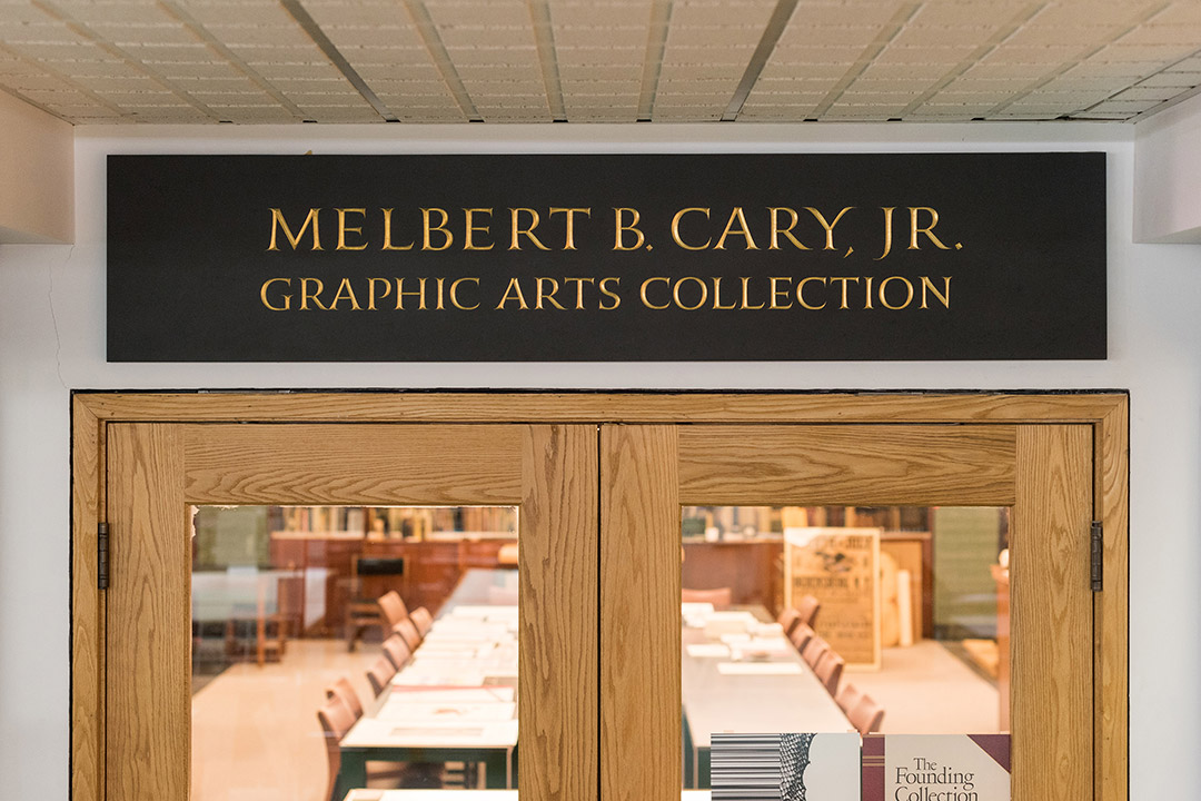 Inscription above glass doors with wood fram reads: Melbert B. Cary Jr. Graphic Arts Collection.