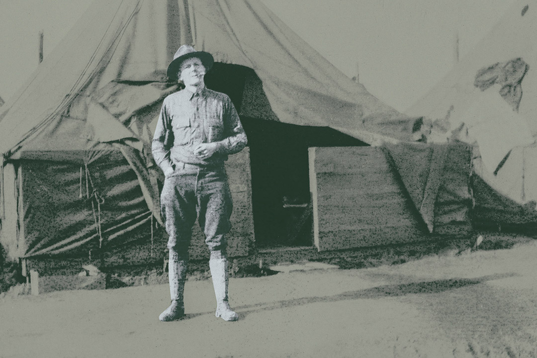 'Soldier stands in front of tent in 1917.'
