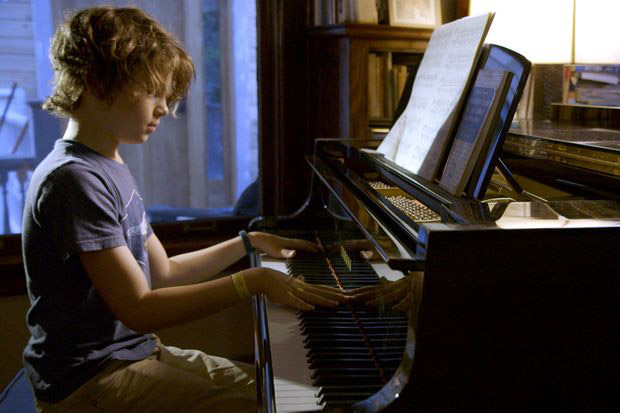 'Boy plays piano.'