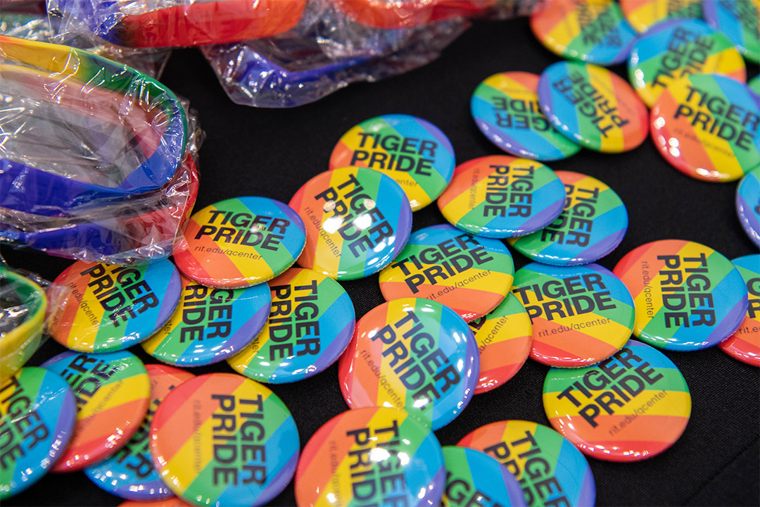'Tiger Pride rainbow buttons.'