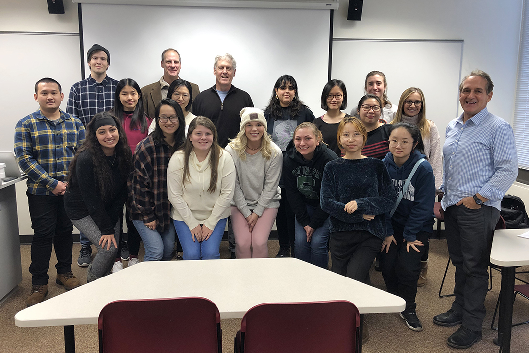 Students, faculty and Dean Todd Jokl pose for a photo with Steve Sasson