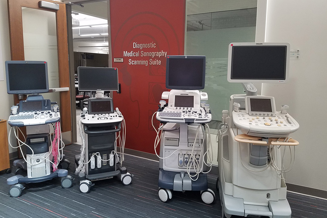 Four mobile ultrasound machines.