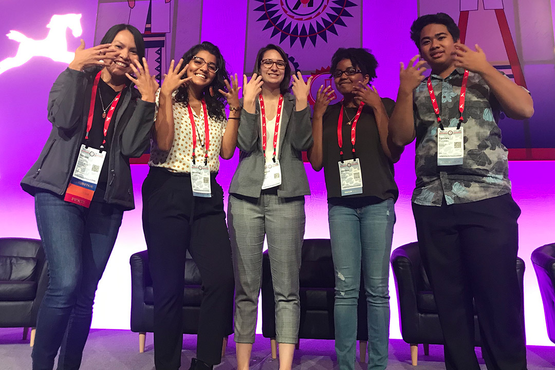 "'group of 5 students does the American Sign Language sign for ""tiger""'"