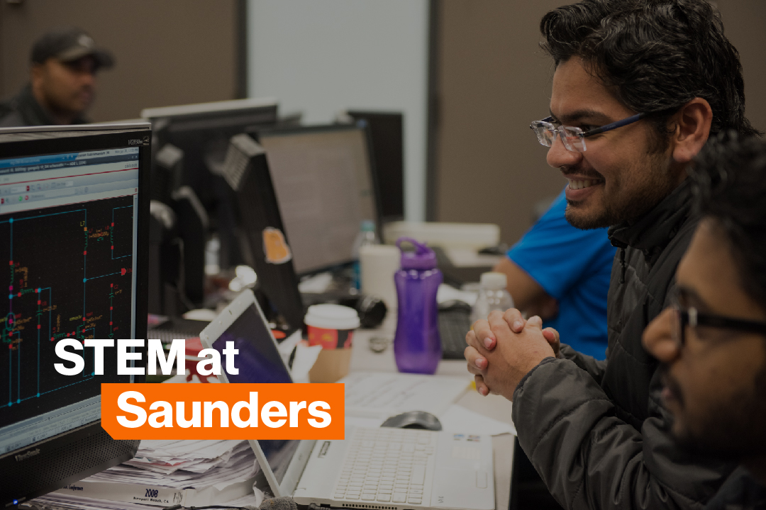 A Saunders international student studies in one of the computer labs.