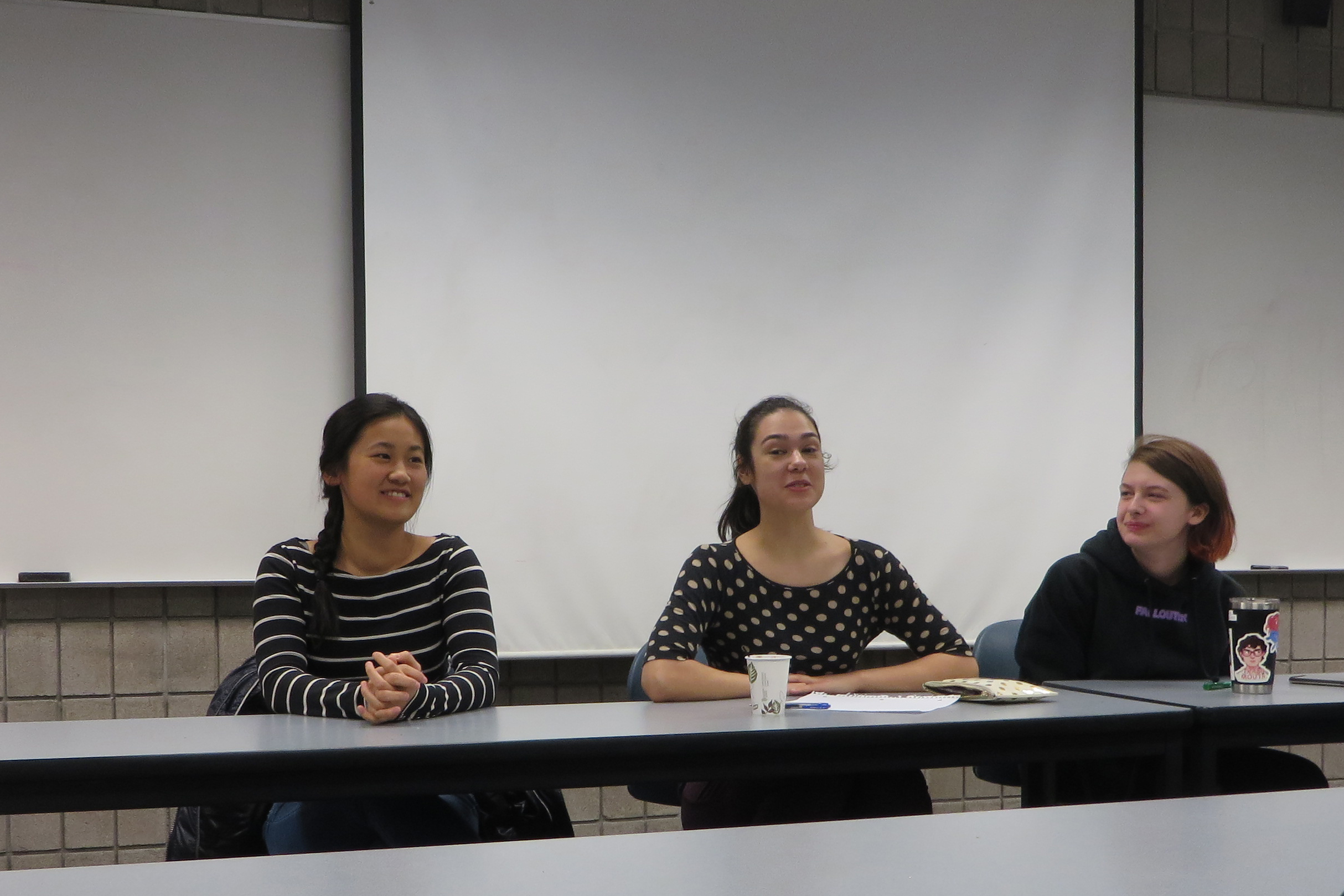 panel of three female students sitting at a table
