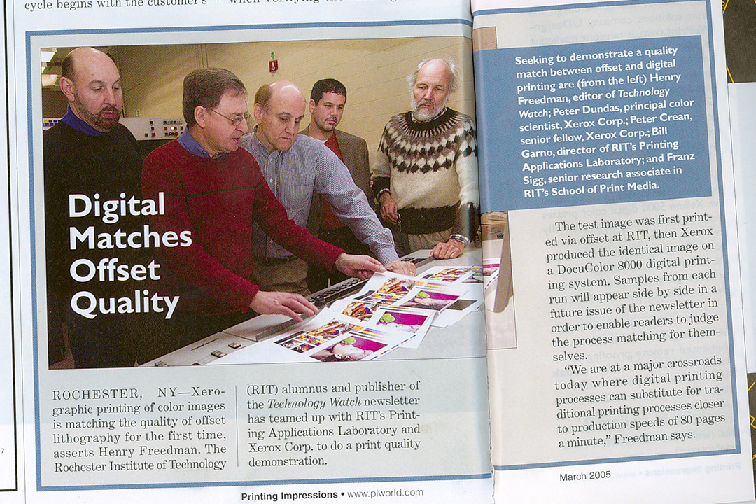magazine story featuring scientists comparing print copies of color images.