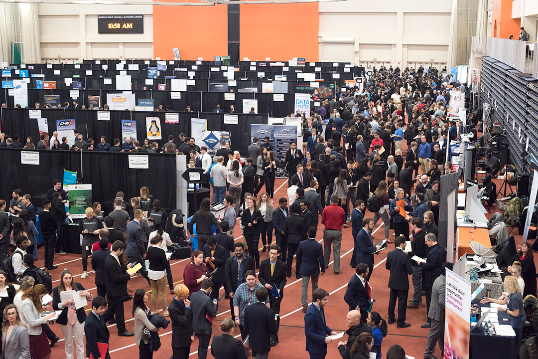 crowd of people attending a career fair.