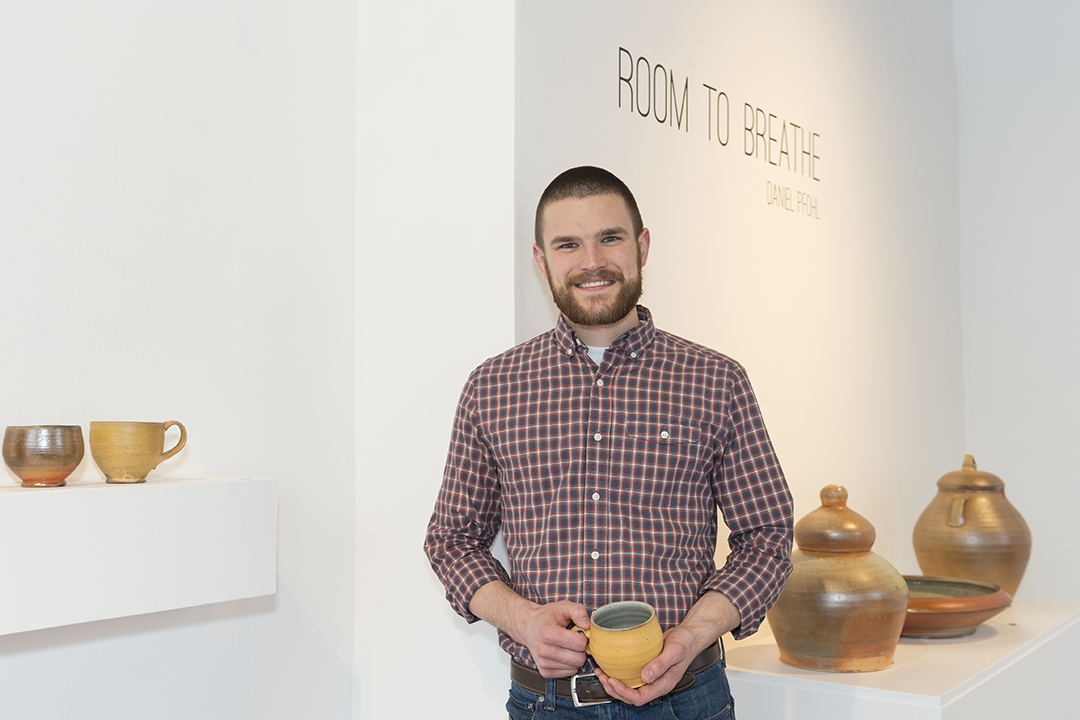 Dan Pfohl at the opening of his 2018 ceramics thesis exhibit at Flower City Arts Center.