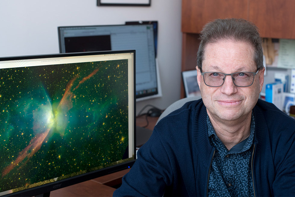 reseacher with view of space on computer screen.