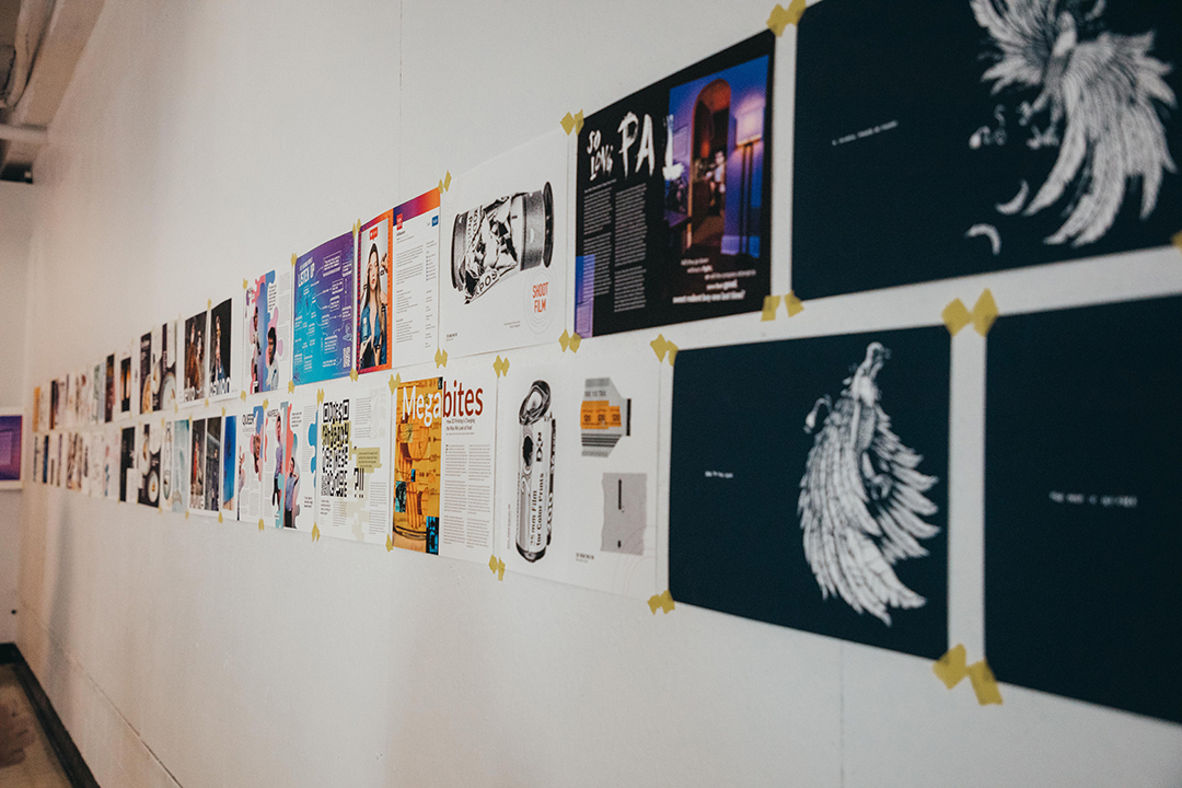 Ellipse 2019 spreads are displayed on a wall.