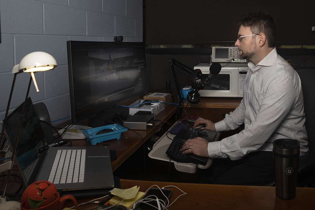 Faculty Shaun Foster works on the computer in his office.