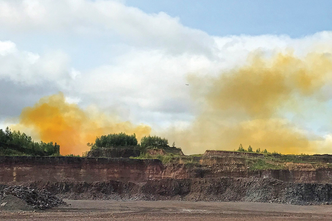 blast zone with yellow-orange gas in the background.