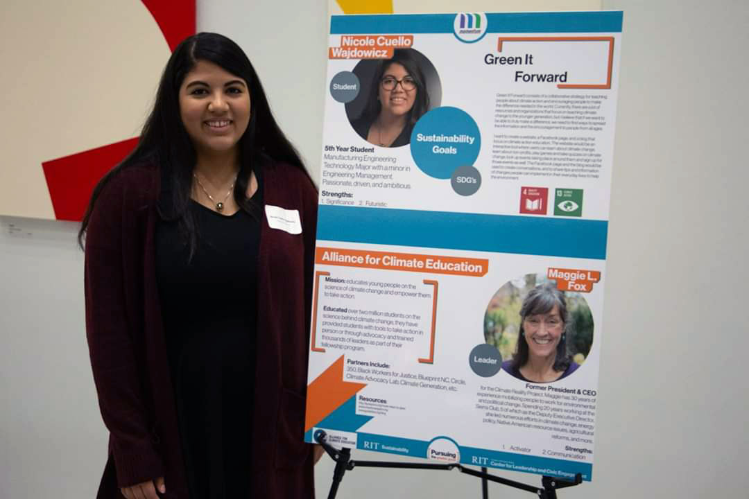 student standing with poster presentation.