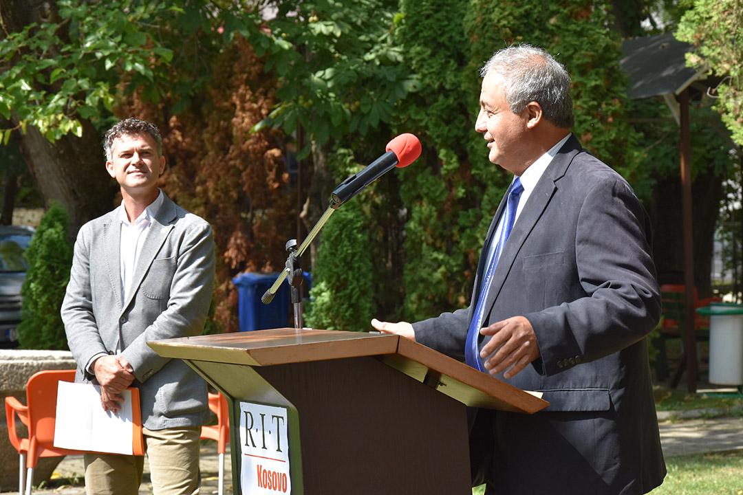 RIT Kosovo president speaking at podium outdoors.