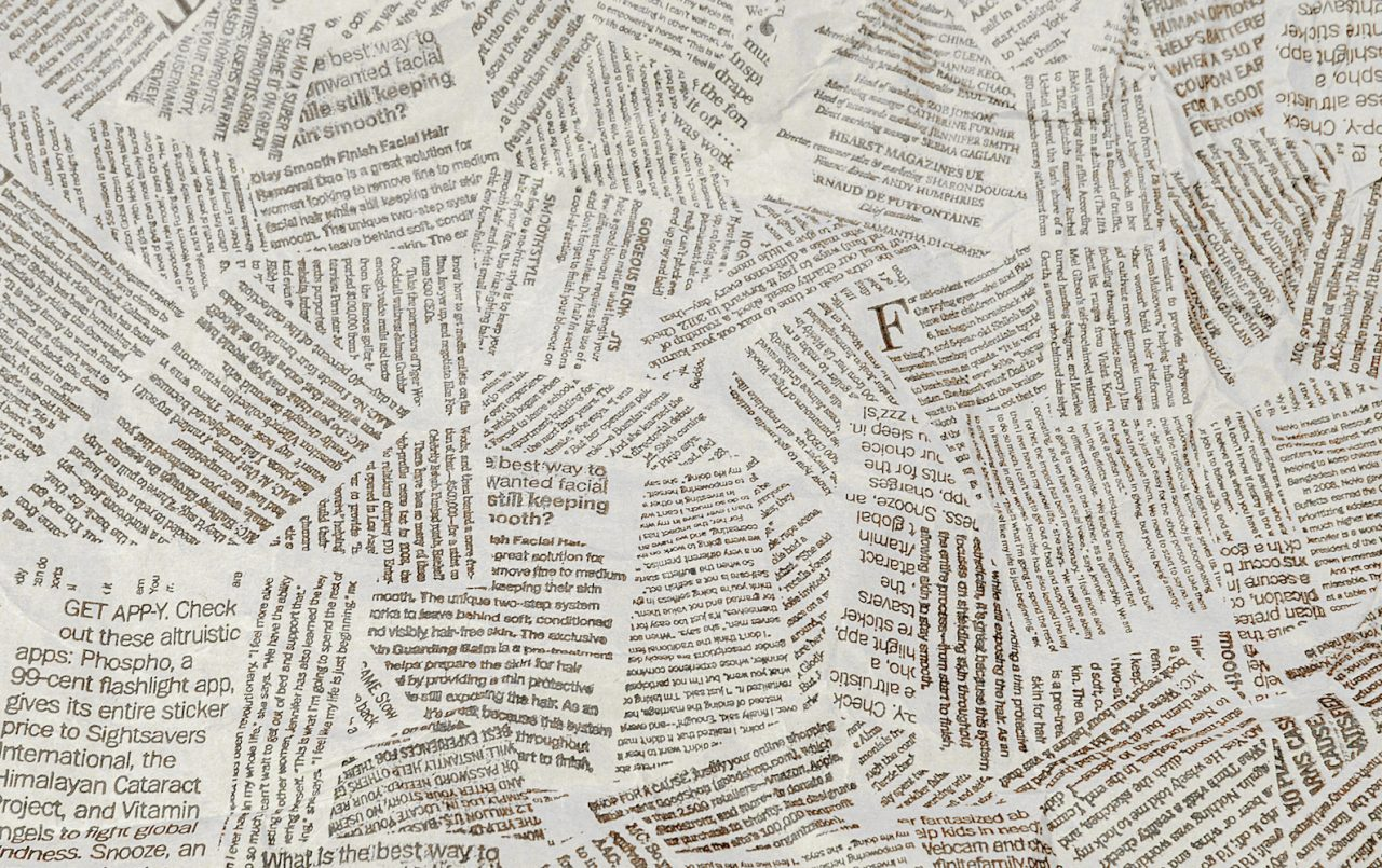 Papers on floor with words