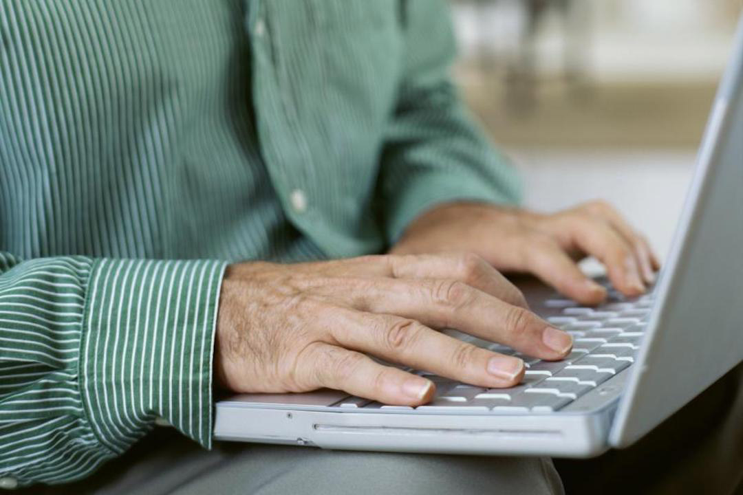 person typing on laptop.