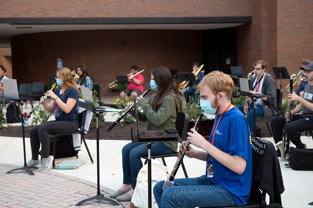 members of concert band practicing outside.
