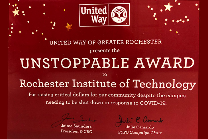 award that says: United Way of Greater Rochester presents the Unstoppable Award to Rochester Institute of Technology for raising critical dollars for our community despite the campus shutting down in response to COVID-19.