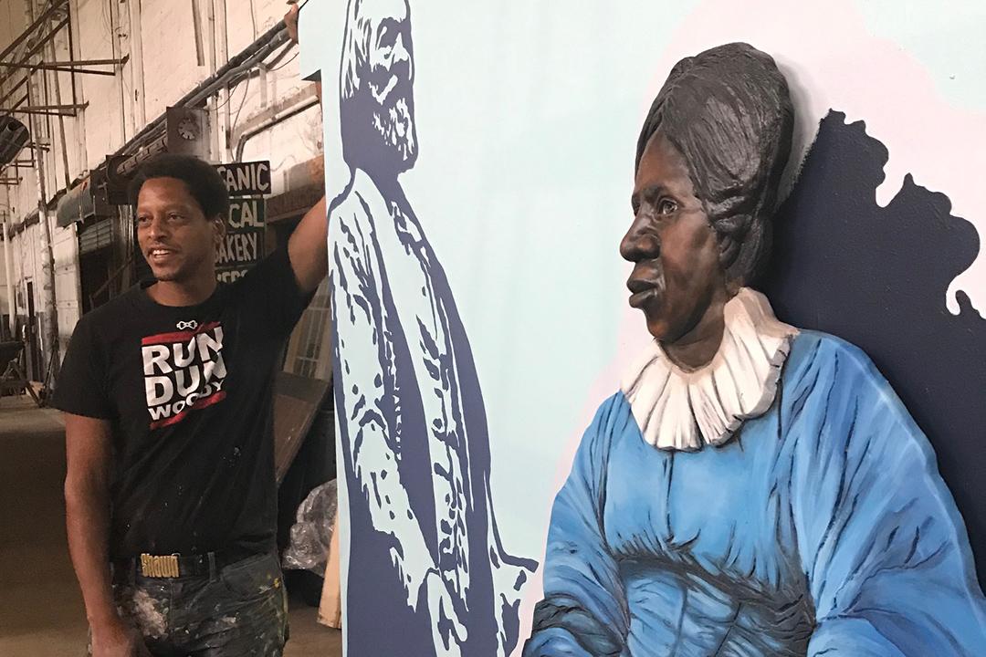 artist standing next to sculpture of Anna Murray Douglass, wife of Frederick Douglass.
