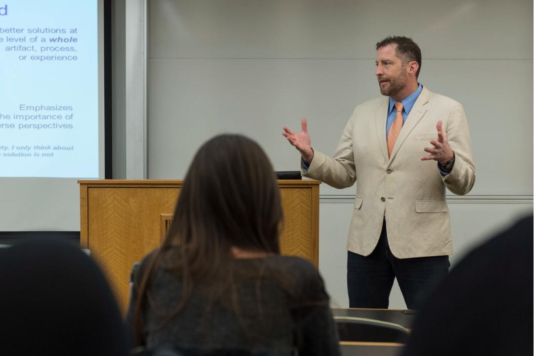 Sean Hansen, Ph.D. speaking in front of a classroom