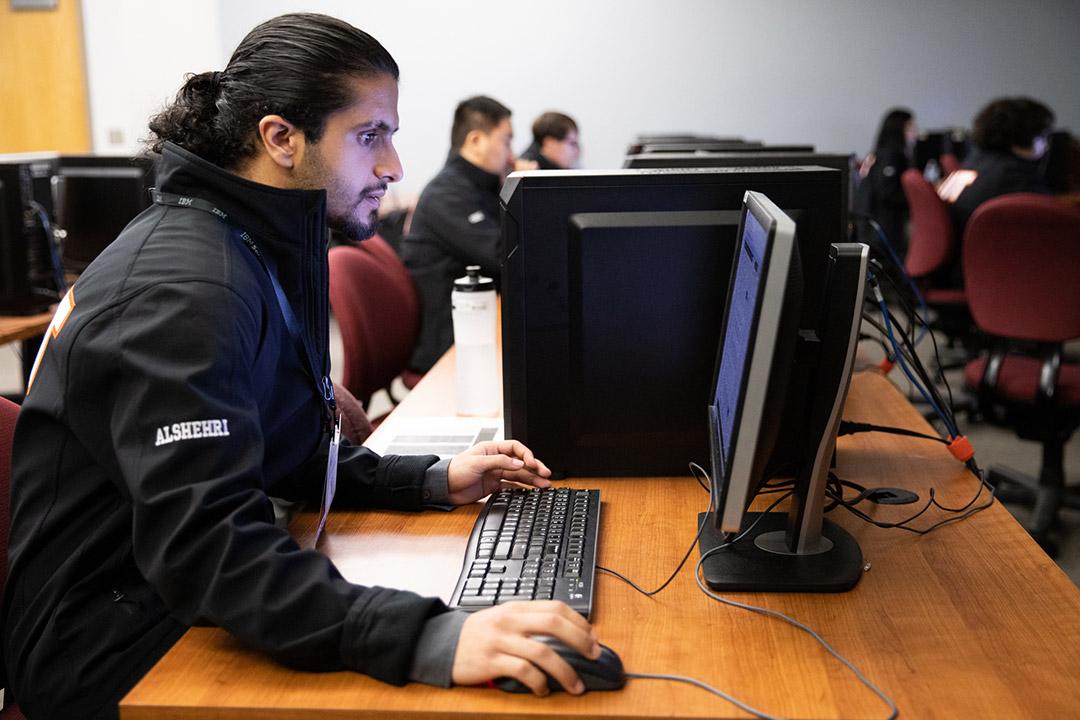 student using a desktop computer.