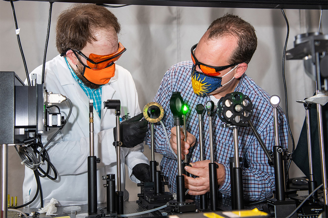 two researchers testing different lenses.