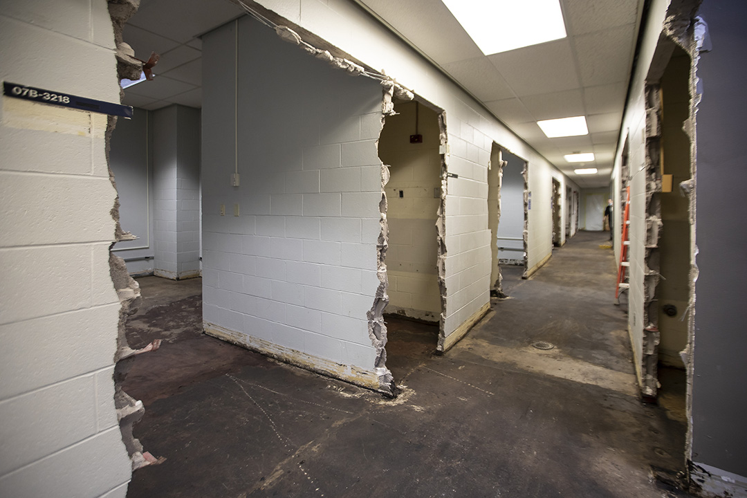 A photo of hallway walls knocked down and getting ready for construction.