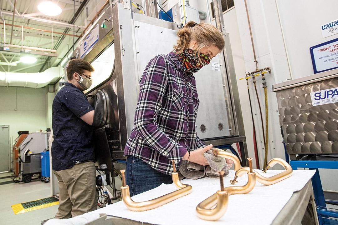 researcher cleaning door handle.