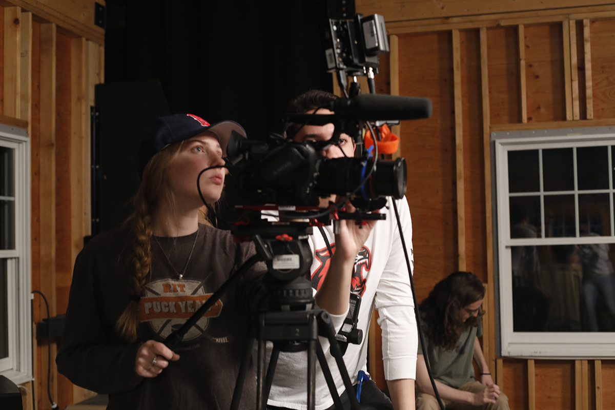 Gayle McAdams operates a camera in the soundstage.