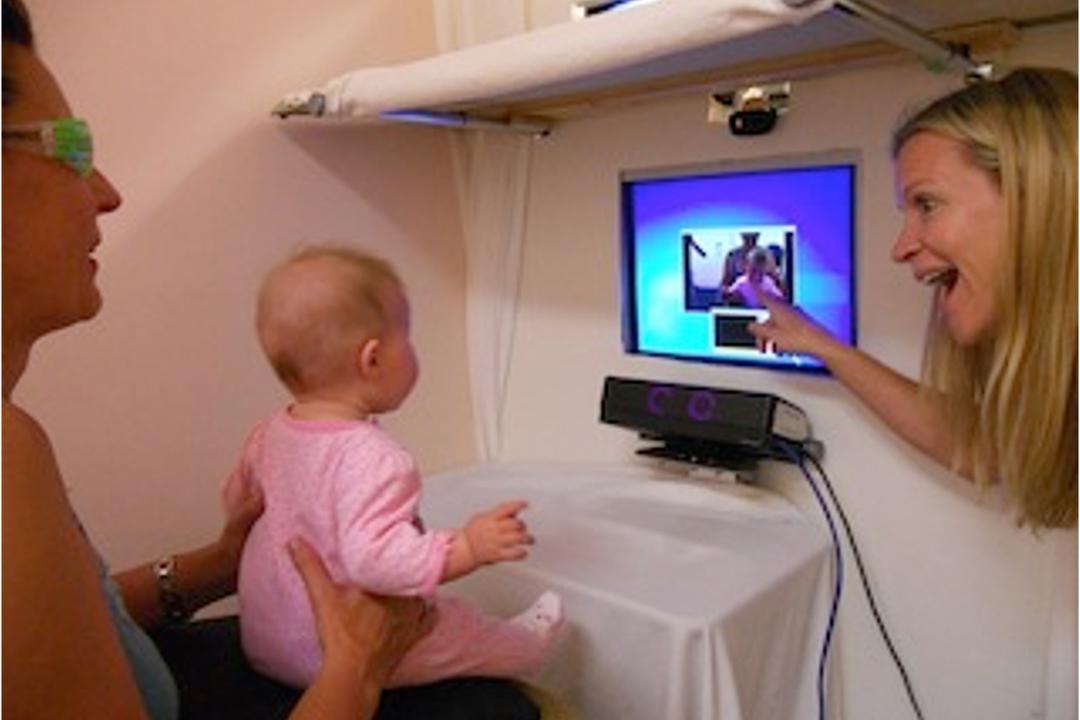 baby looking at a computer screen.