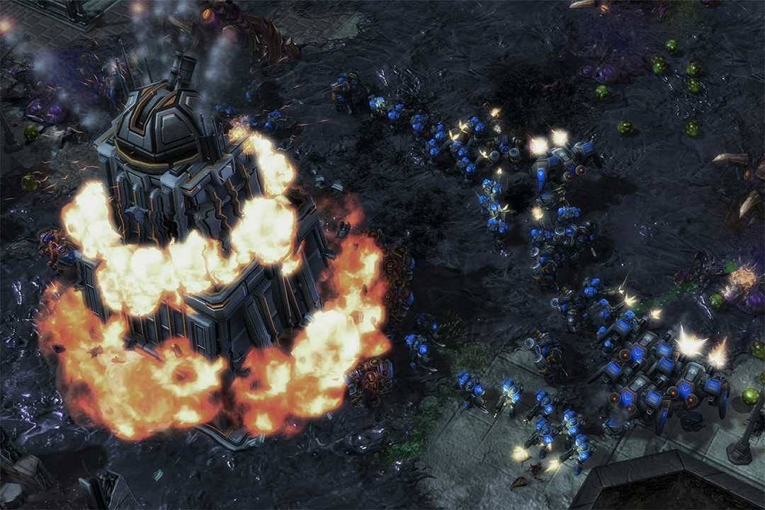 screenshot of building on fire in the video game Starcraft 2.