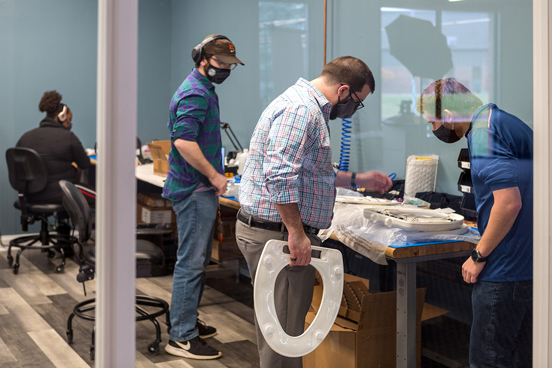 people working on toilet seat prototypes.