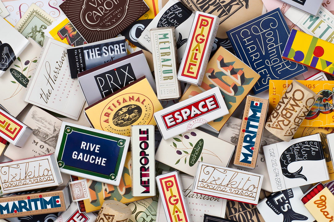 several matchbooks with varying designs and fonts.