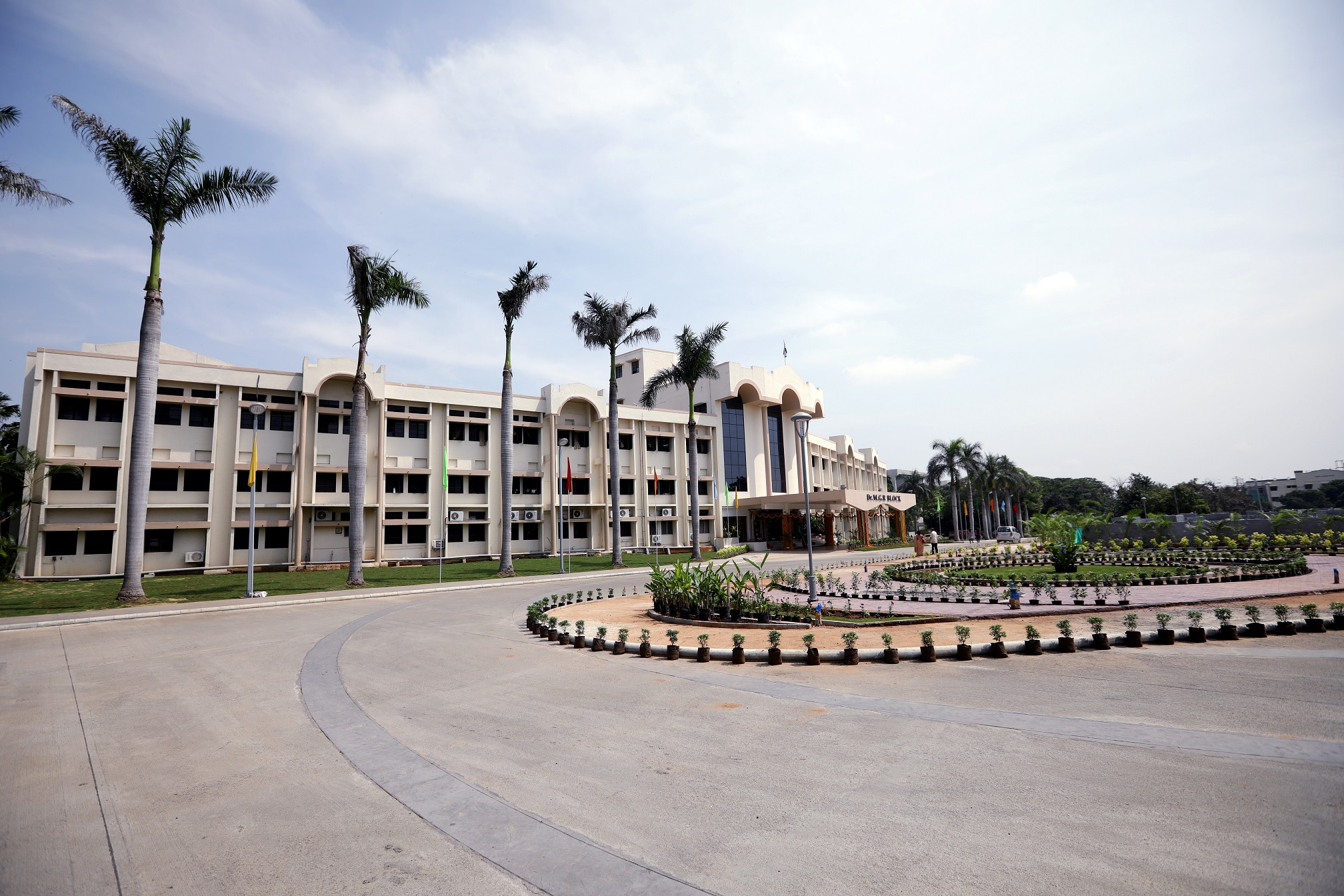 Vellore Institute of Technology (VIT) campus in India. White building with palm trees.
